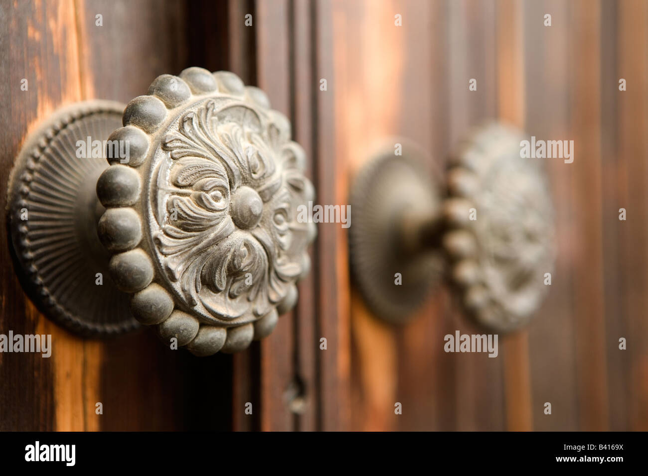 An old door knob in the Troodos Mountain village of Kakopetria. - Stock Image