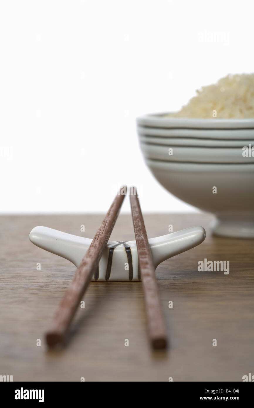 Chopsticks on a chopstick holder - Stock Image