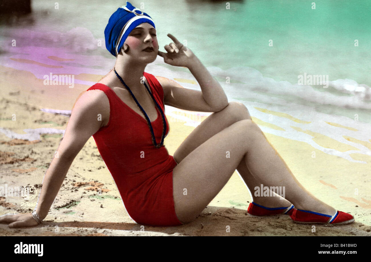 bathing, swimsuit, young woman, wearing swimsuit, sitting on the beach, 1920s, coloured postcard, red, bathing suit, fashion, sandy beach, bathing cap, , Stock Photo