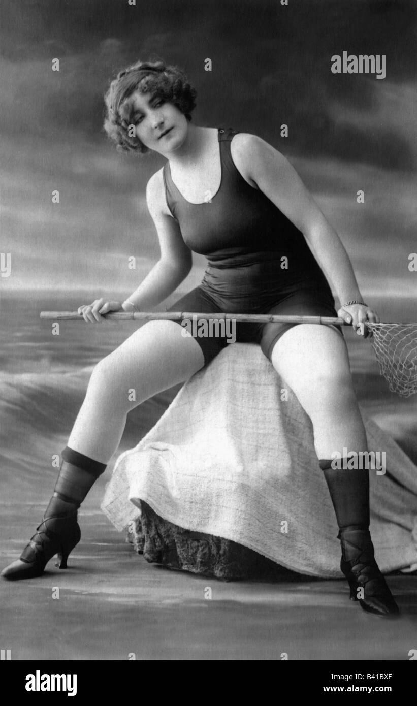 bathing, swimsuit, young woman, wearing swimsuit, full length, sitting, studio, 1920, Stock Photo