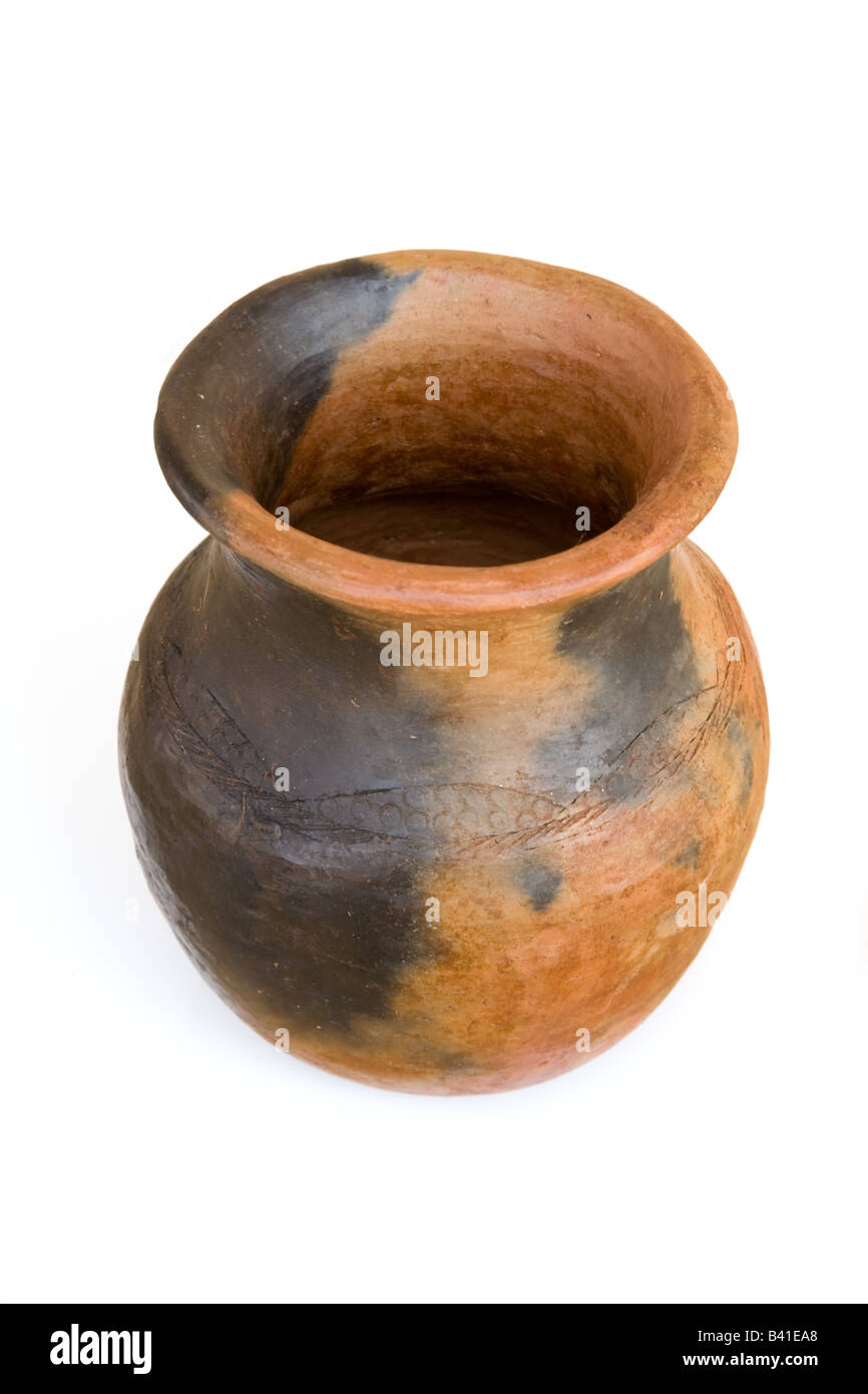Terracotta water pot isolated on a white studio background Zambia Africa - Stock Image