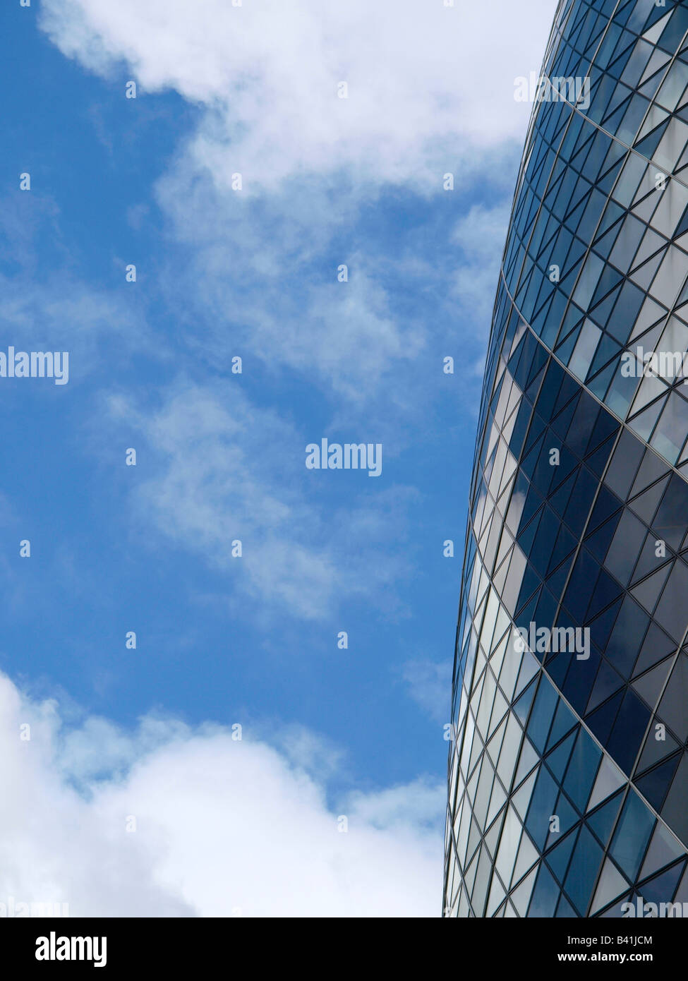 Gherkin detail with blue sky and clouds London city United Kingdom - Stock Image