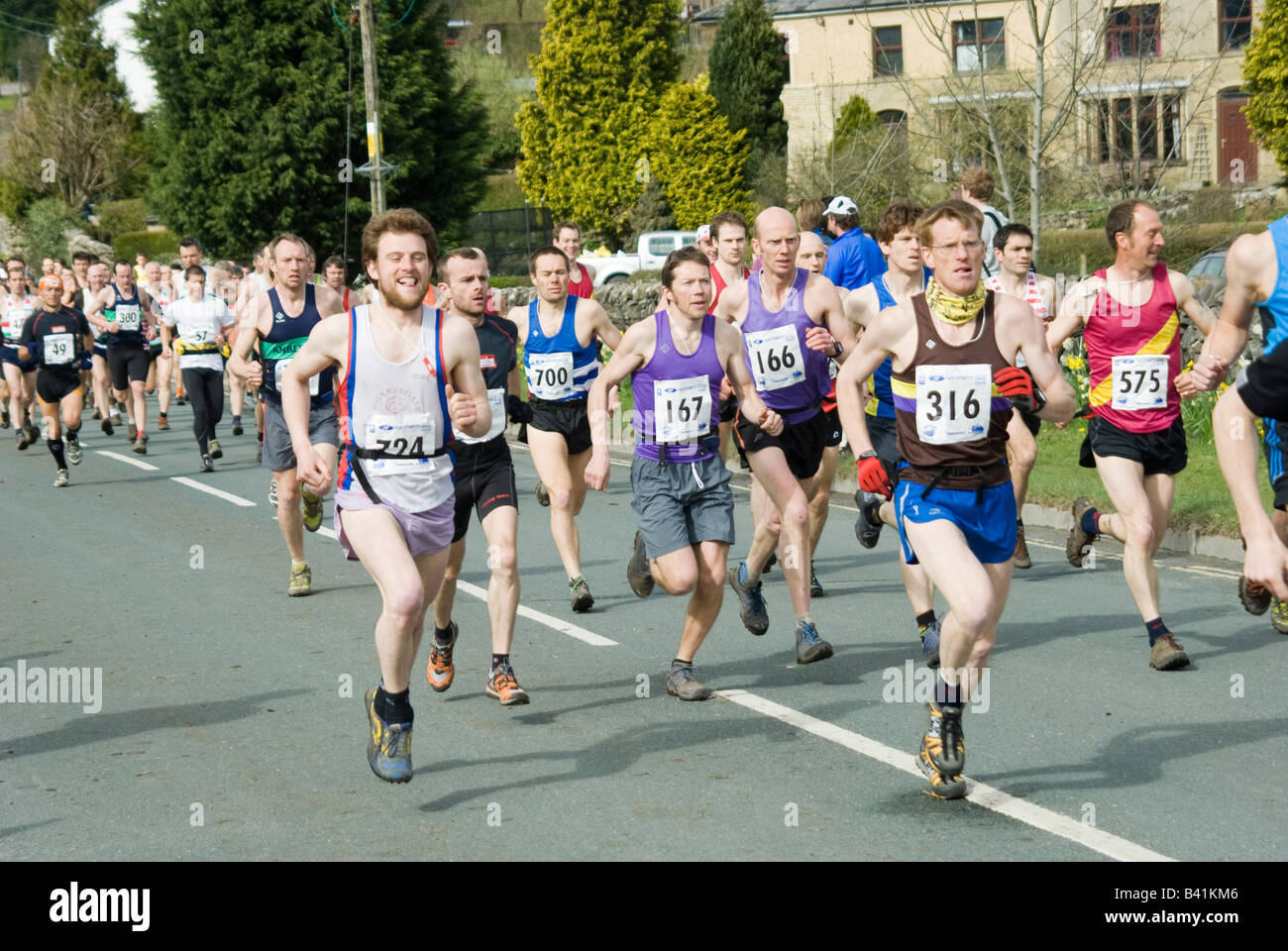 People competing in the three peaks long distance race challenge in Yorkshire England - Stock Image