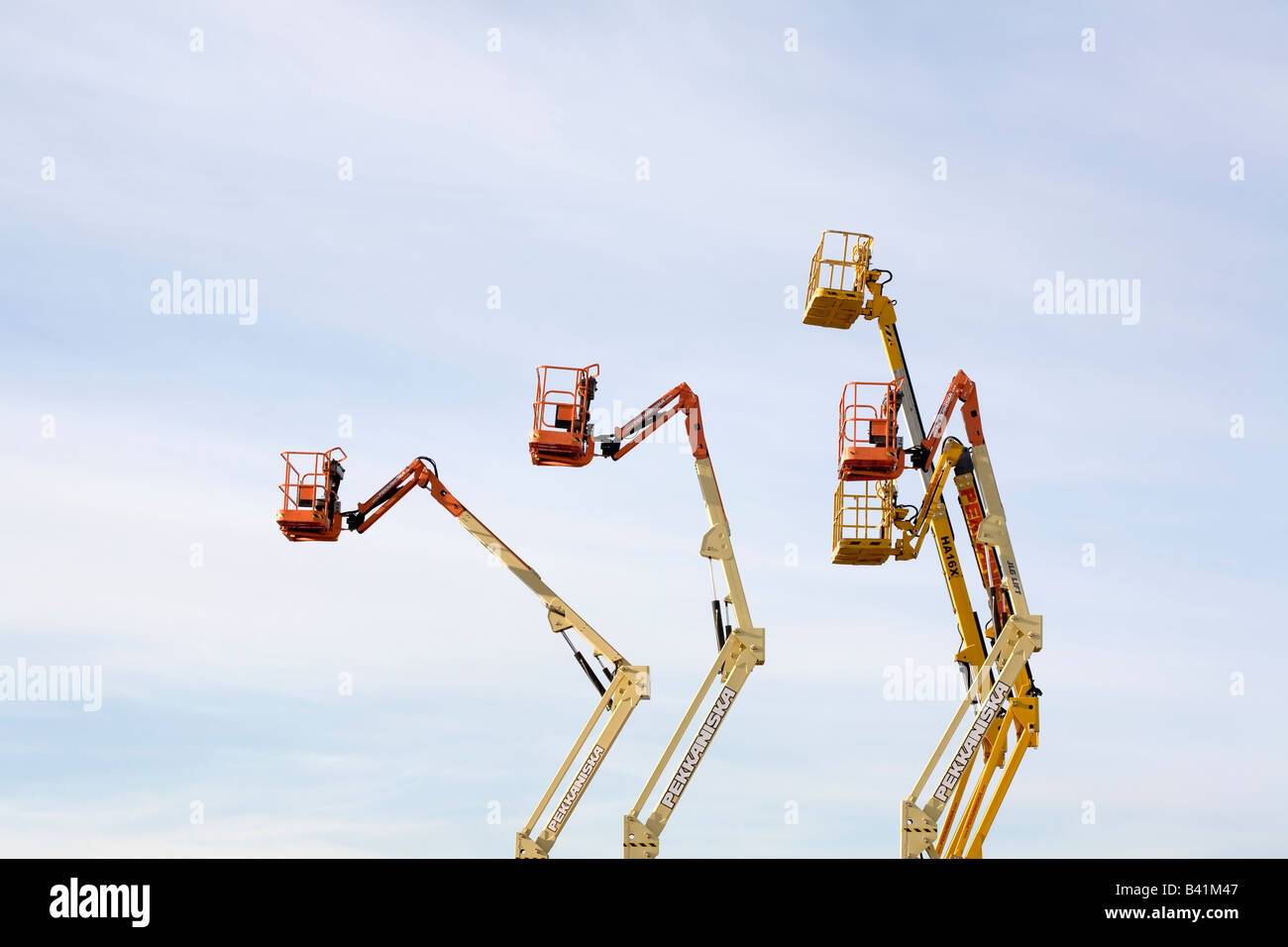 5 lift truck baskets up in the air - Stock Image