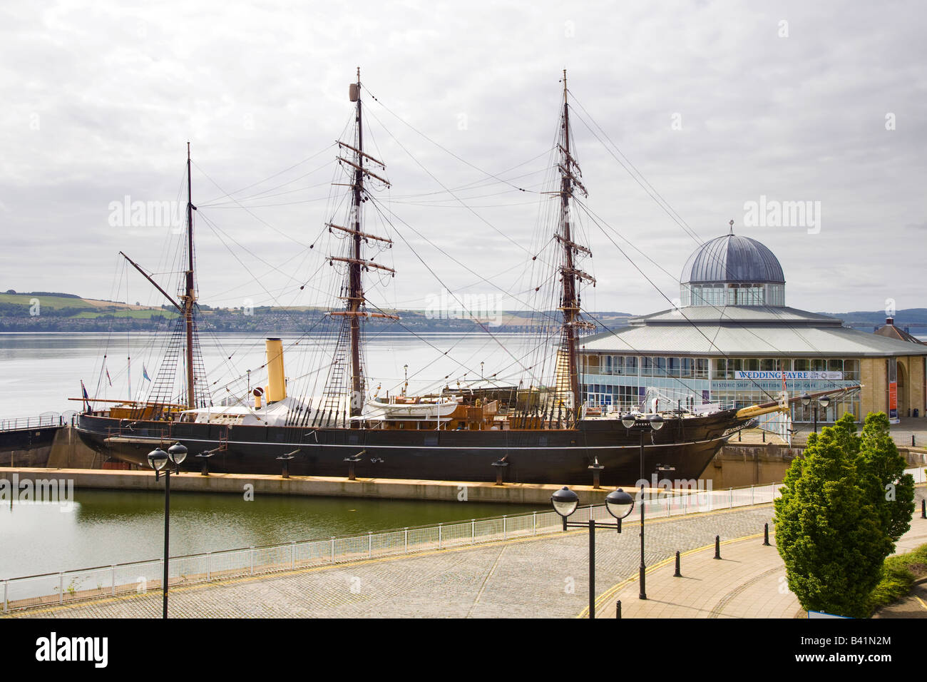 Antarctic research vessel  RRS traditional wooden three-masted ship at Discovery Point and Visitor Centre in Dundee, - Stock Image