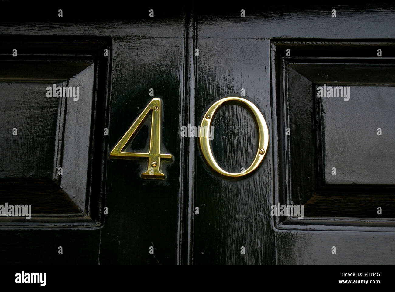 40 Forty sign on a door - Stock Image