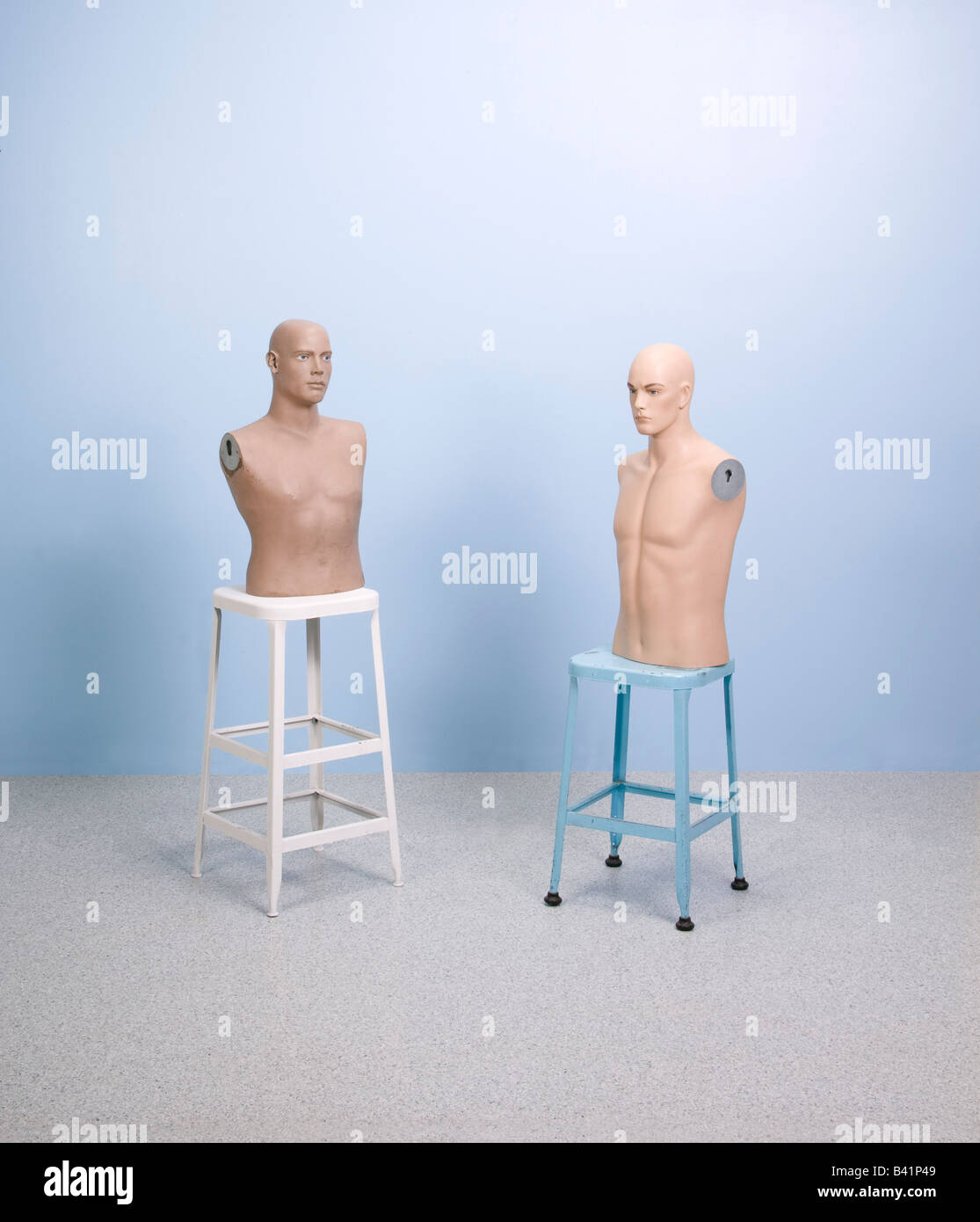 mannequins on stools - Stock Image