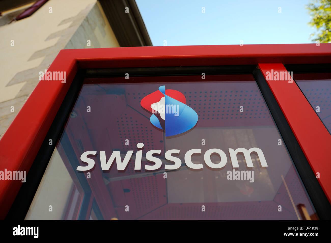 Telephone booth with swisscom logo on it. - Stock Image