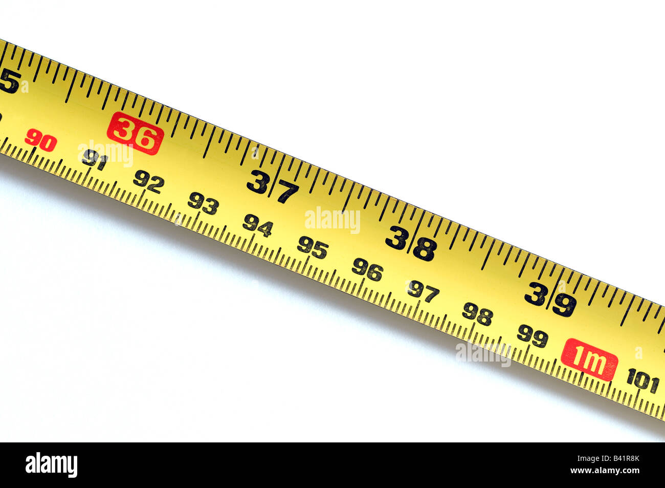 36 inches a 1 metre on a yellow steel rule - Stock Image