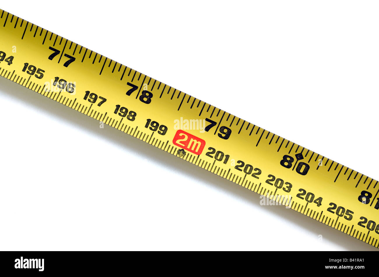 2 metres on a yellow steel rule - Stock Image