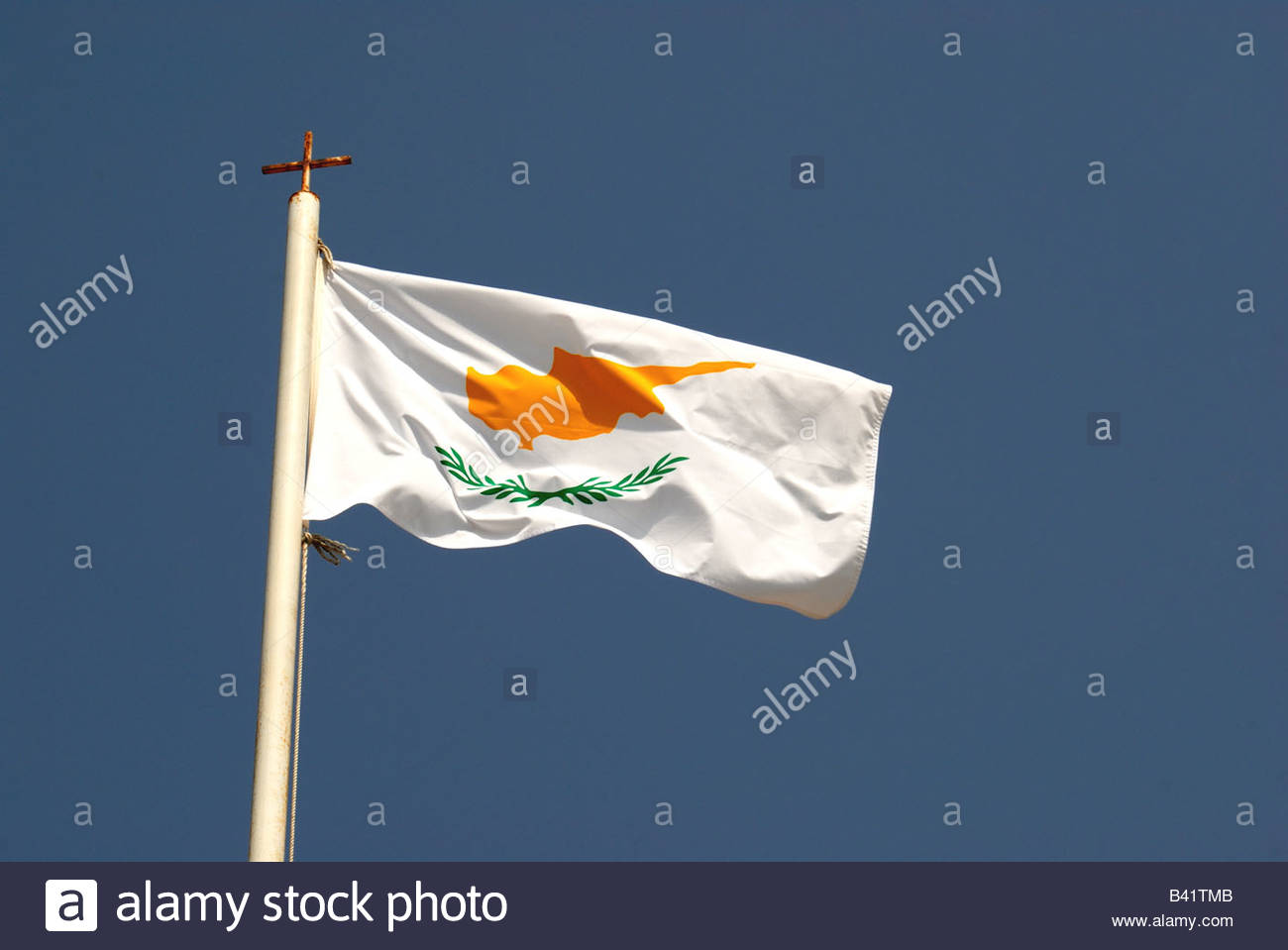 The Cypriot flag waving in the wind with a blue sky background. - Stock Image