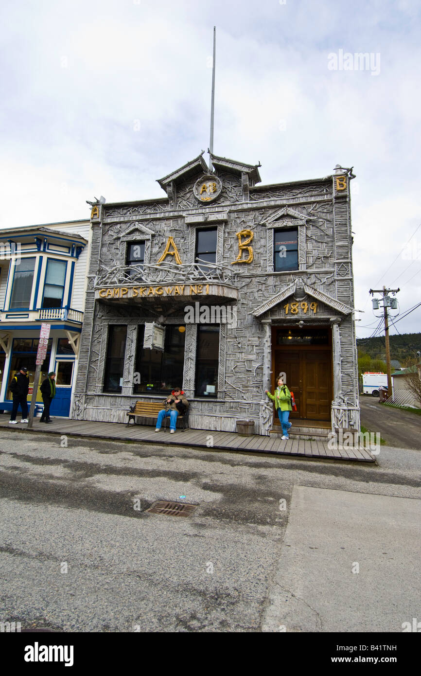 Arctic Brotherhood Hall Skagway Alaska exterior is decorated with pieces of driftwood - Stock Image