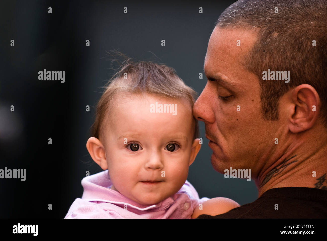 a 35 year old man with his 1 1/2 year old daughter - Stock Image