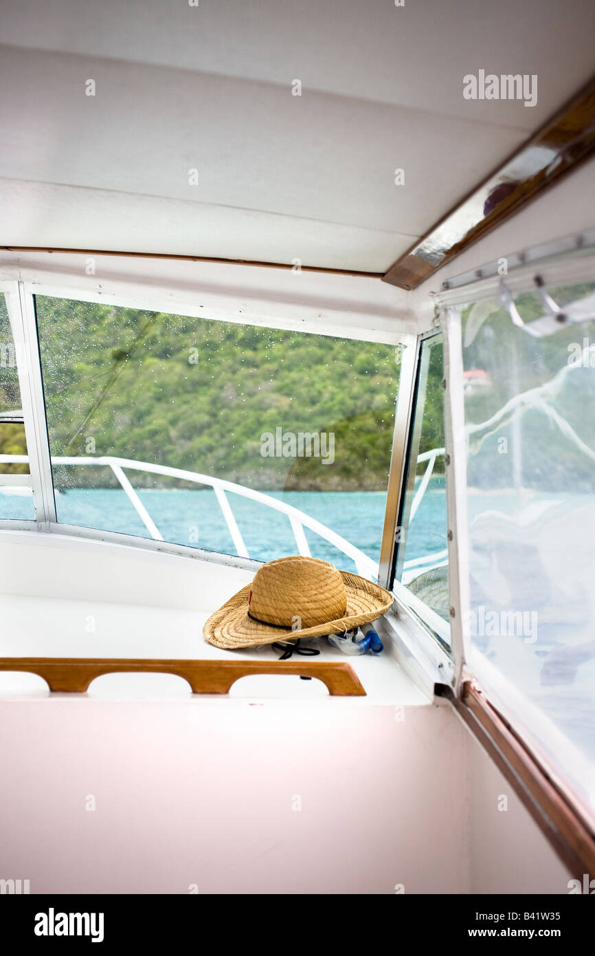 The captain's straw hat is stored for later use. - Stock Image
