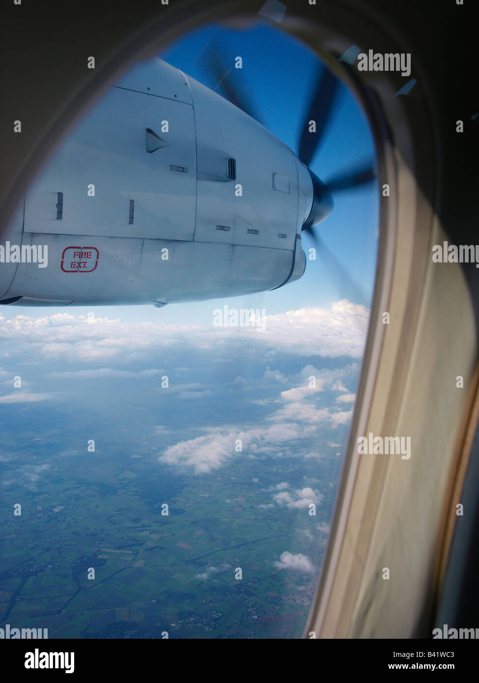 Flying over the south of the Netherlands in a Dornier 328 turboprop aeroplane - Stock Image