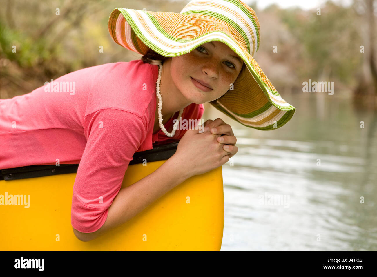 A young girl rests on her canoe, High Springs, Florida. - Stock Image