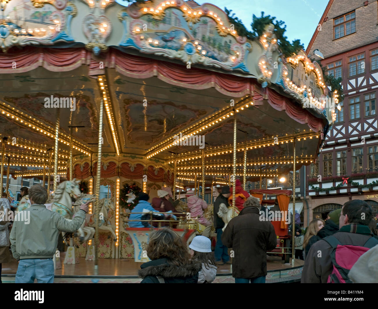 Christmas fair with merry go round with light for children on the ...