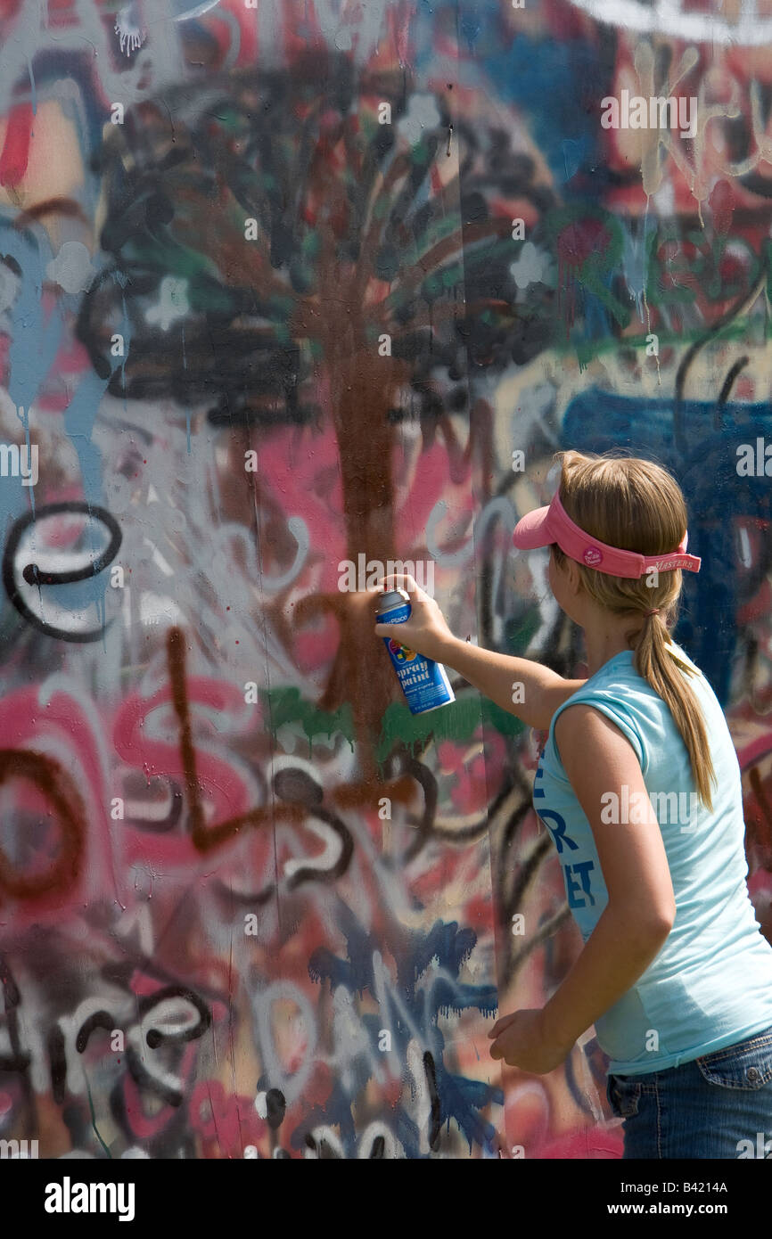 Pro-life girl spray painting. - Stock Image