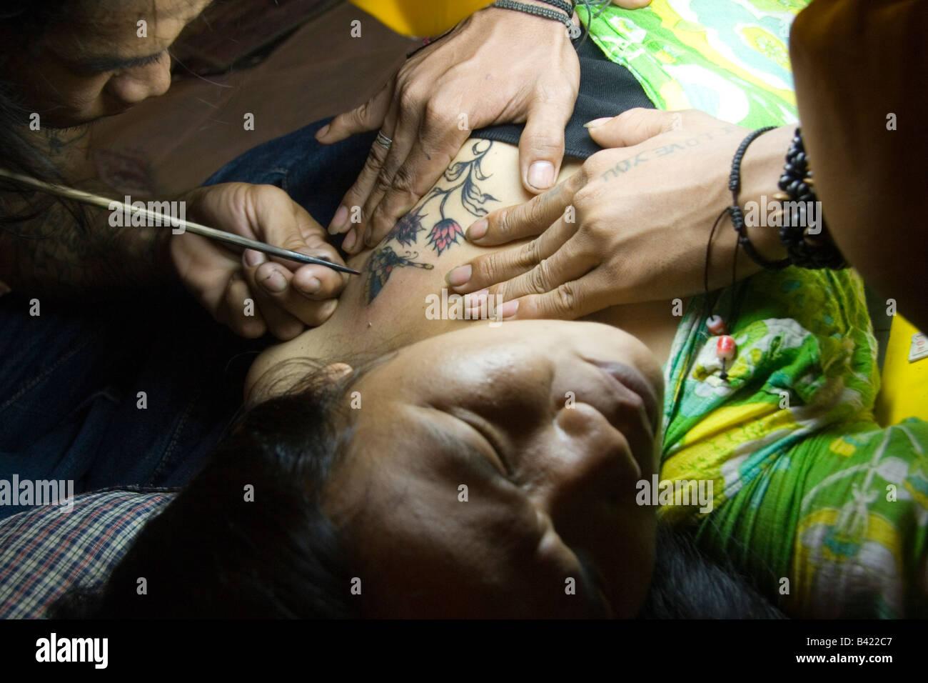 Thai Girl Getting Handmade Tattoo Thailand