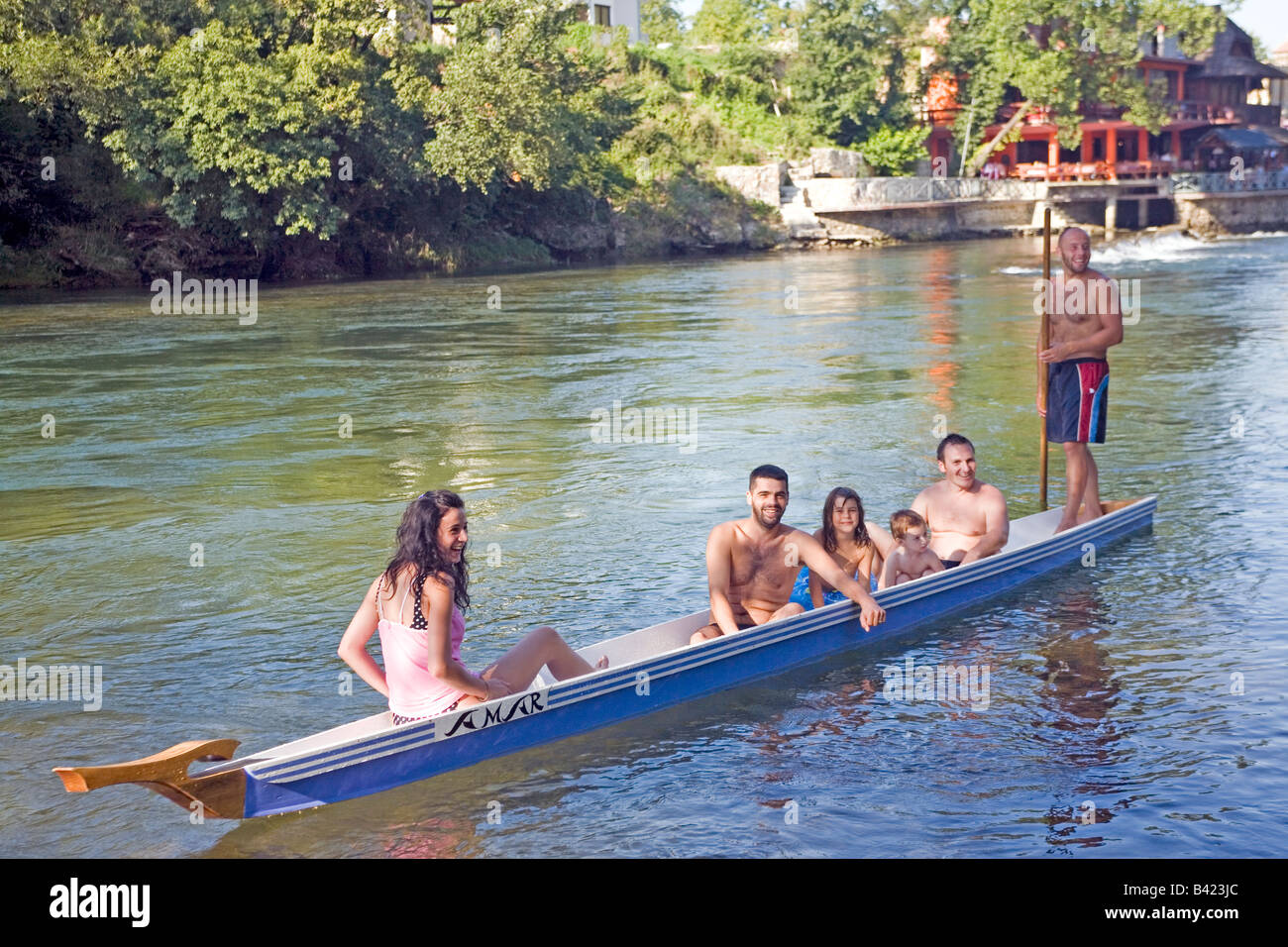 Family with friends in a 'Dajak boat' punt boat the gondola of Banja Luka town, Bosnia, Republic of Srpska - Stock Image