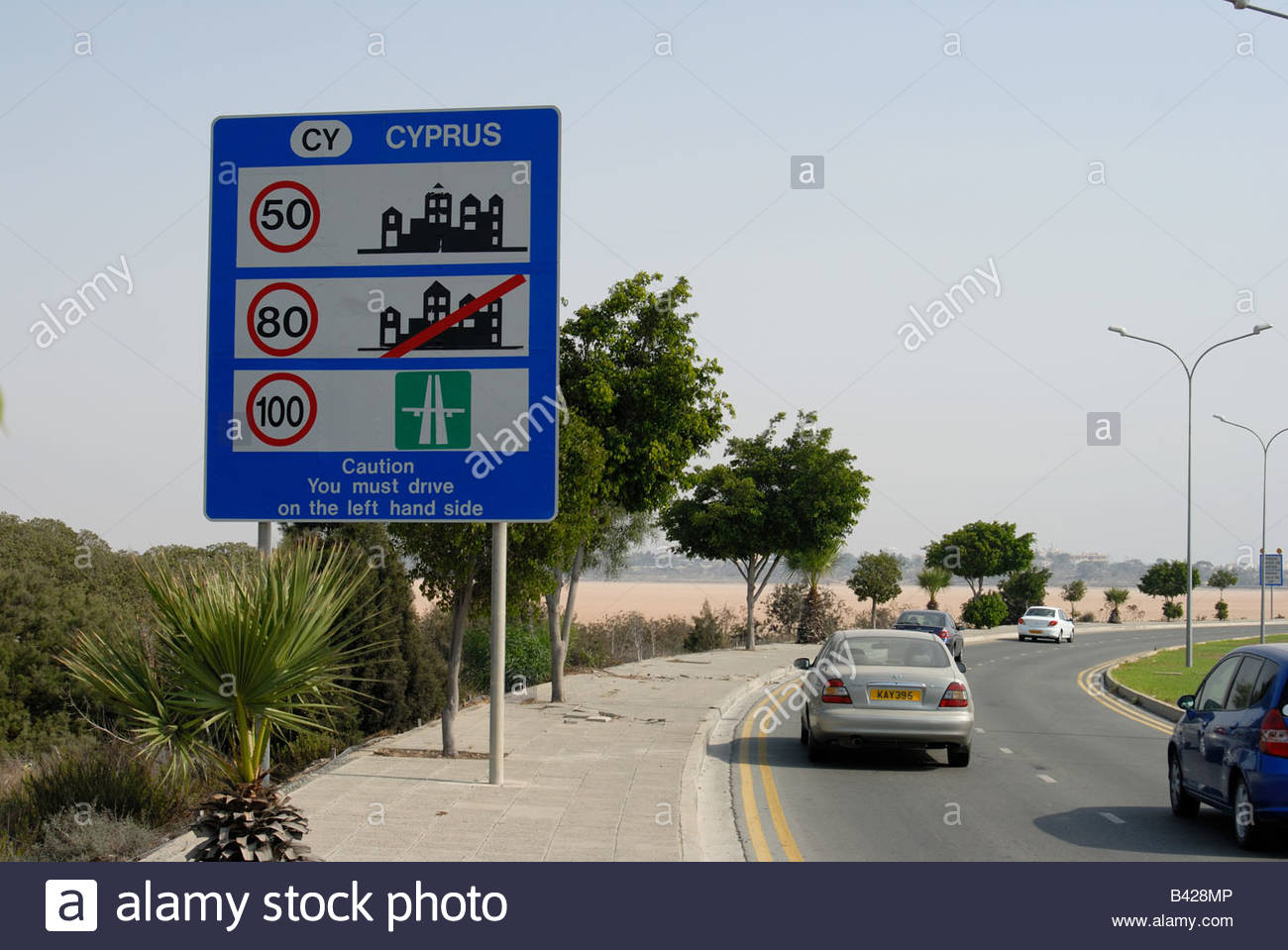Larnaca Cyprus Roadsign with speed limits and indicating that in Cyprus motorists should drive on the left hand - Stock Image