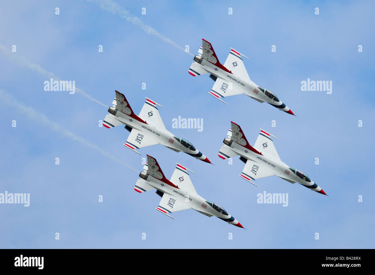 F-16 jet fighter of the aerobatic team Thunderbirds in flight at Elmendorf Air Force Base - Stock Image