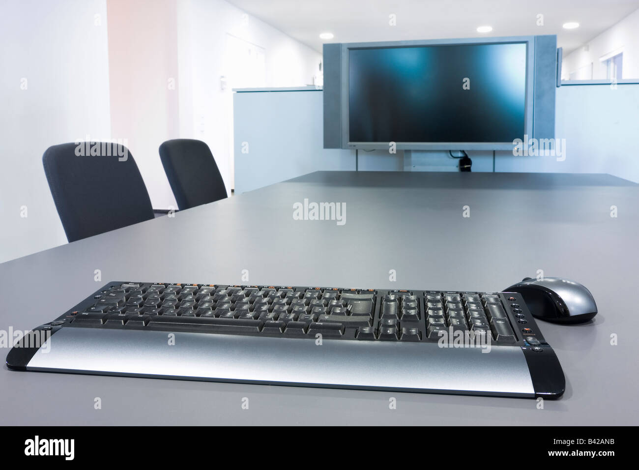 Flat Screen And Computer Keyboard In A Meeting Room Stock Photo
