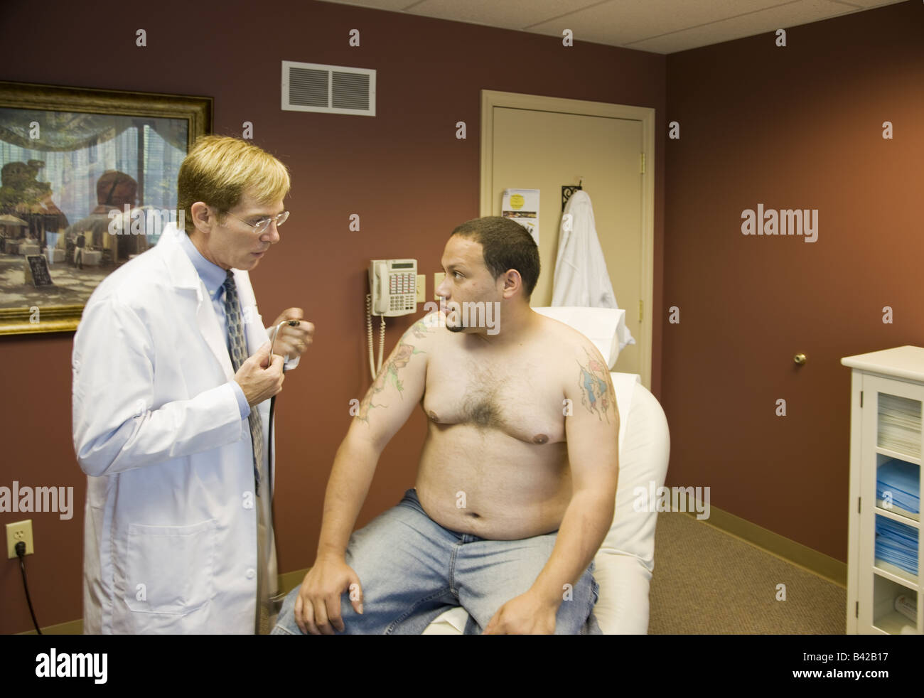 Tattooed patient gets examined by doc