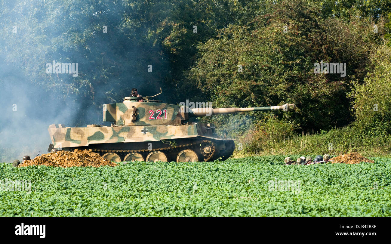 German WWII Tiger Tank crosses a field of young crops in a