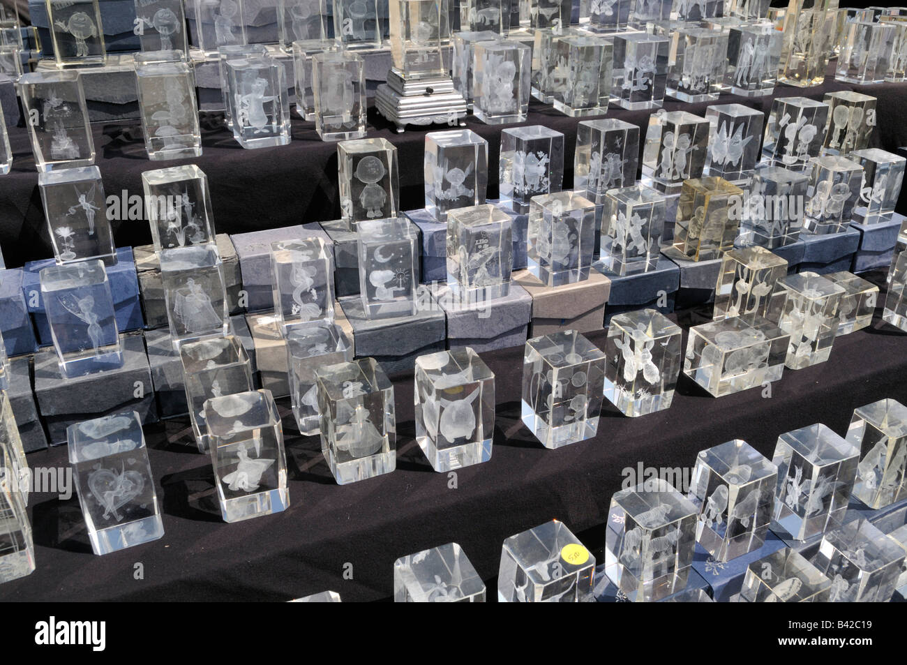 Miniature three dimensional portrait etchings inside cube like glass - Stock Image