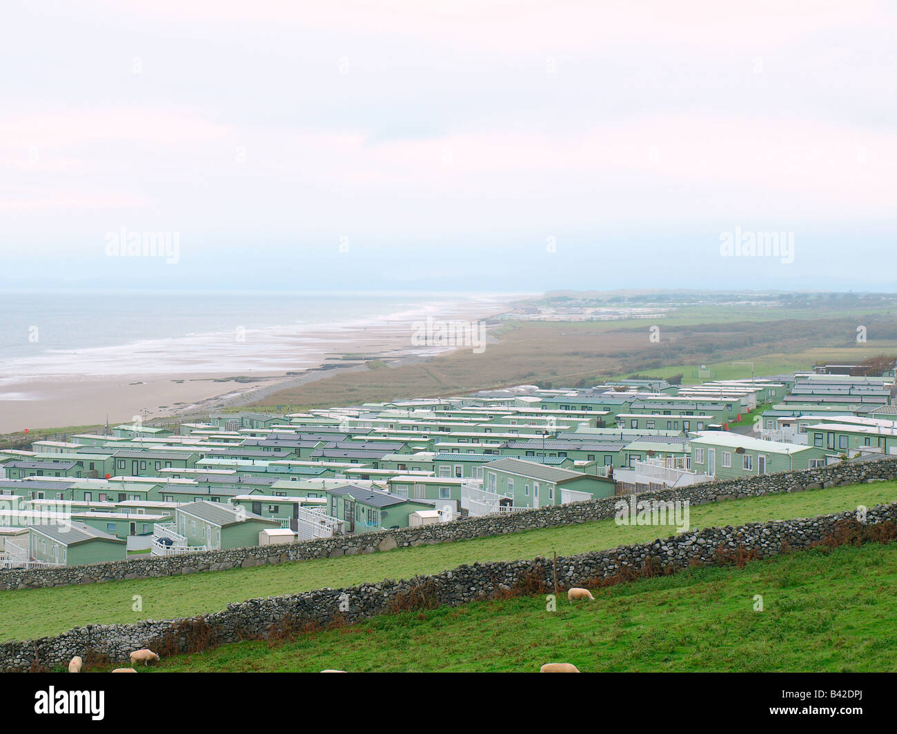 A caravan park and looking out to Bennar beach in Cardigan bay,Barmouth,Wales,uk. - Stock Image