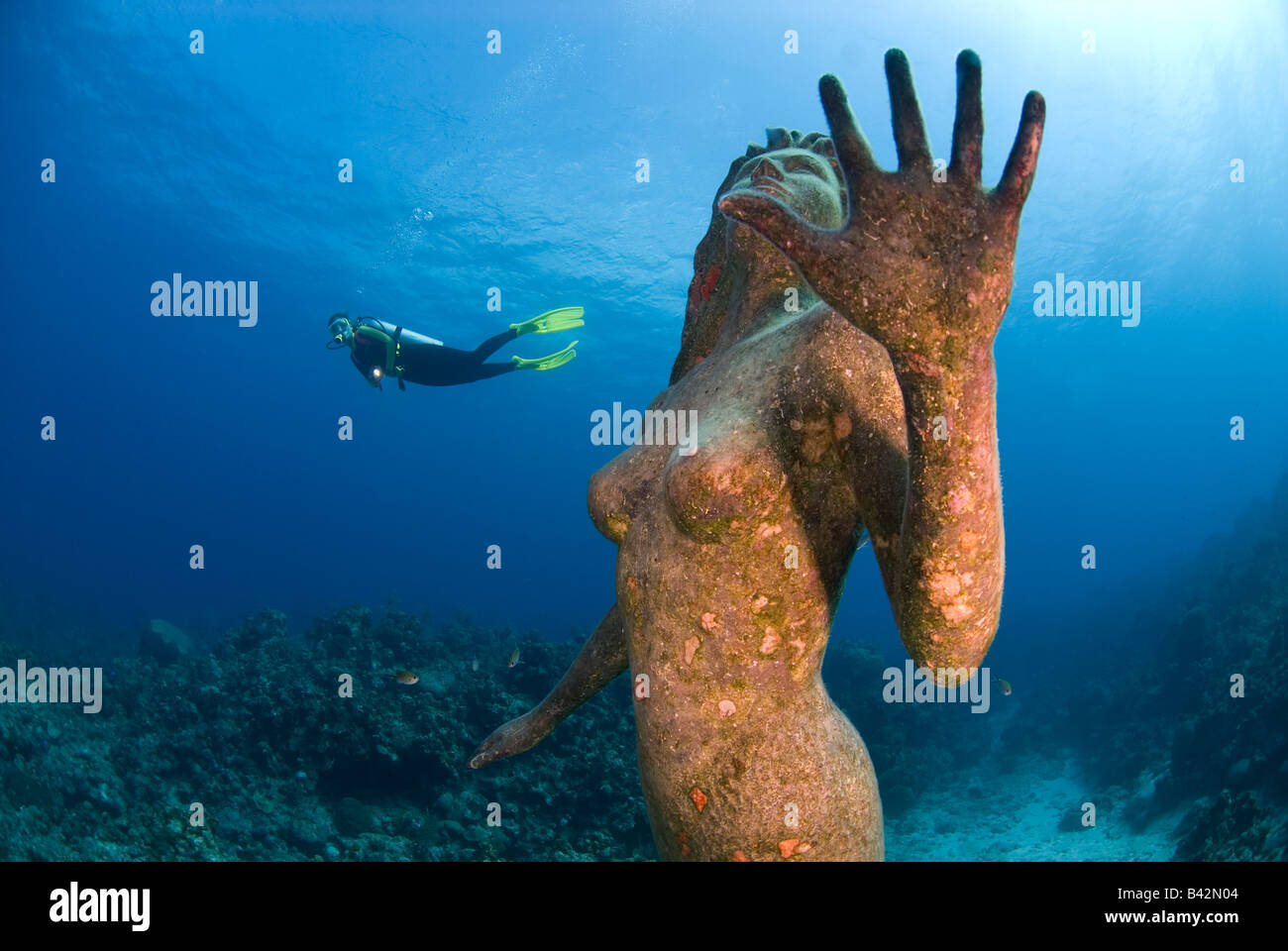 Mermaid Sculpture and Diver Grand Cayman Caribbean Sea Cayman Islands - Stock Image