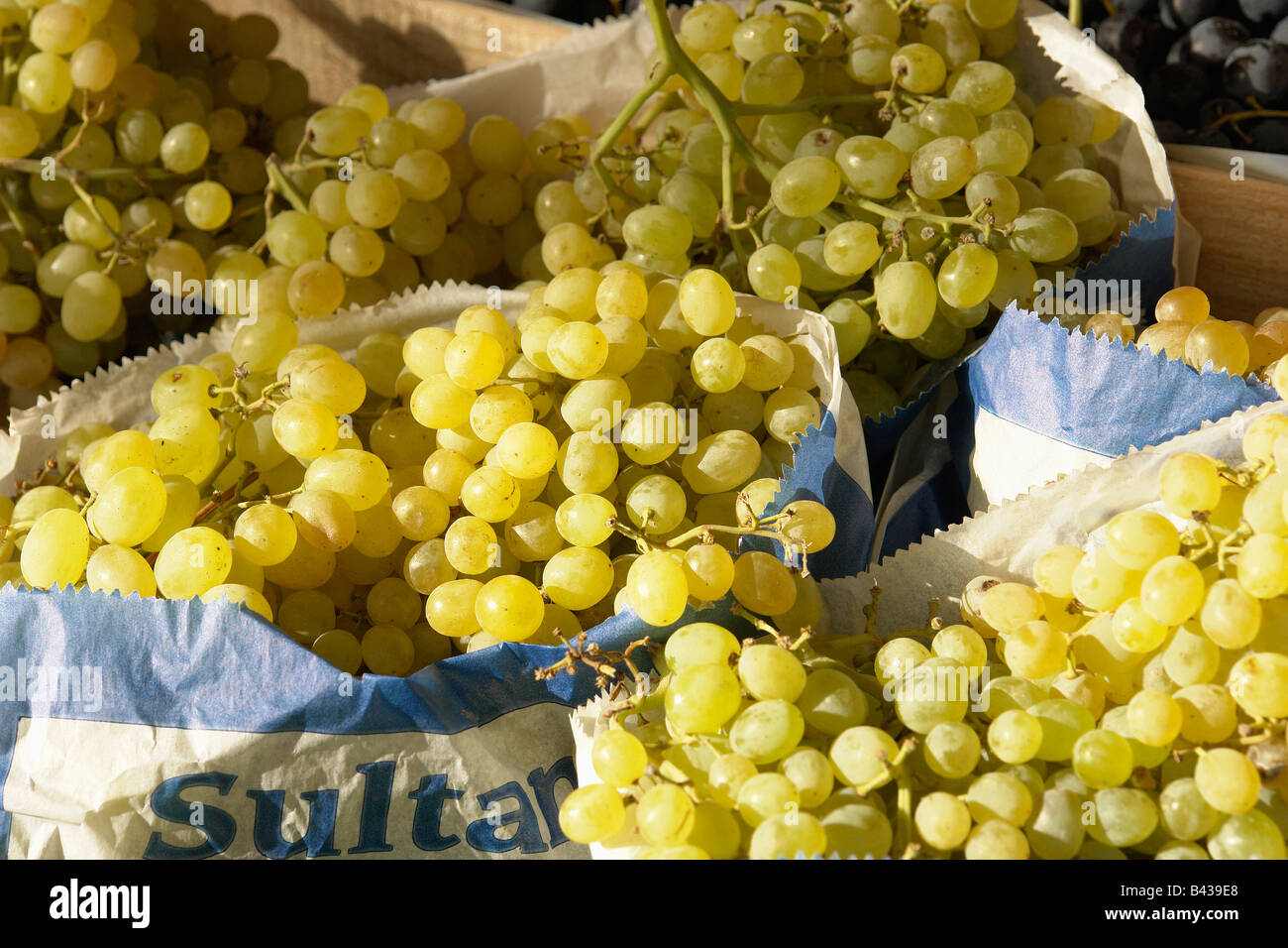 Paper bags of white grapes Stock Photo