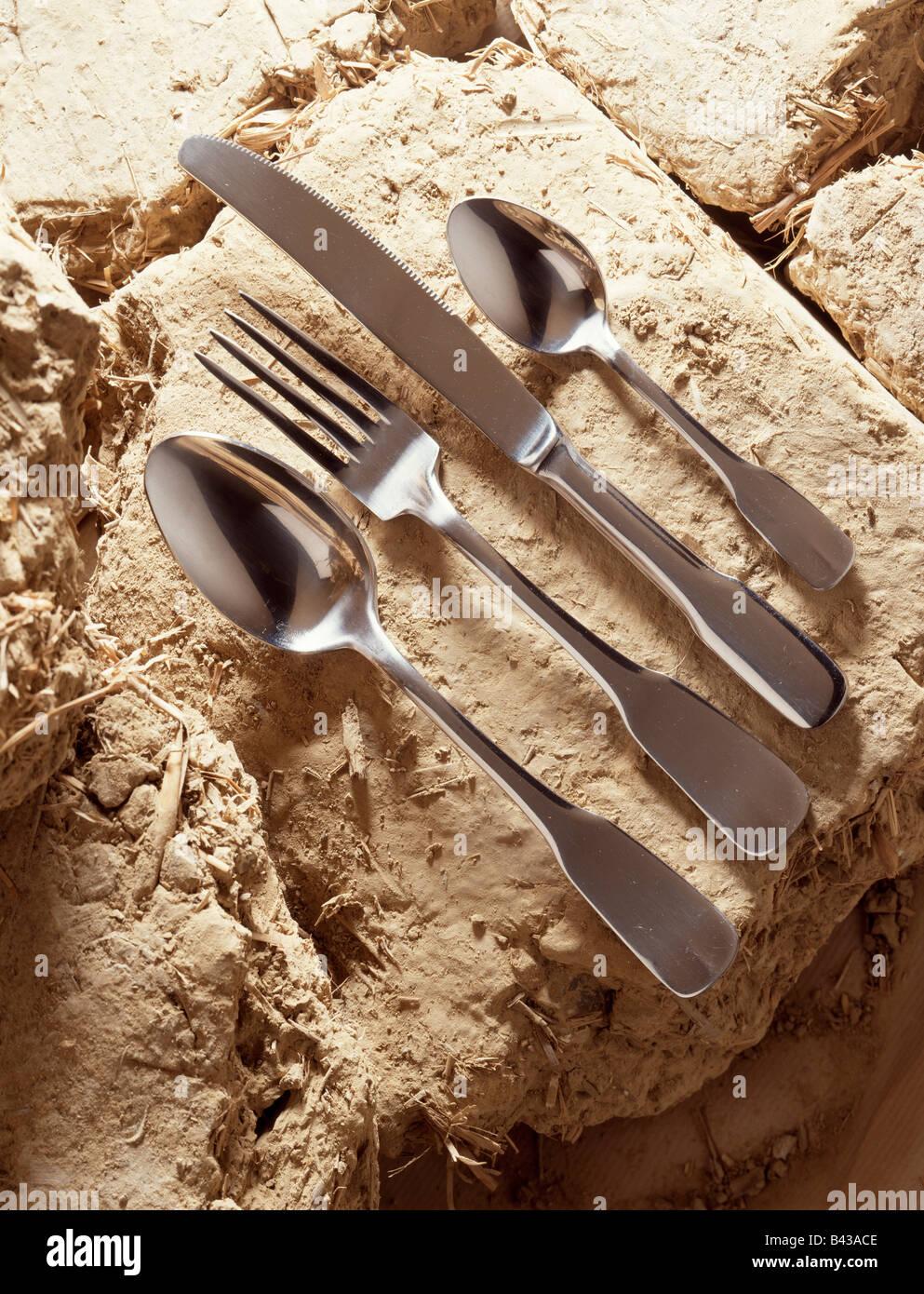 Cutlery on daub - Stock Image