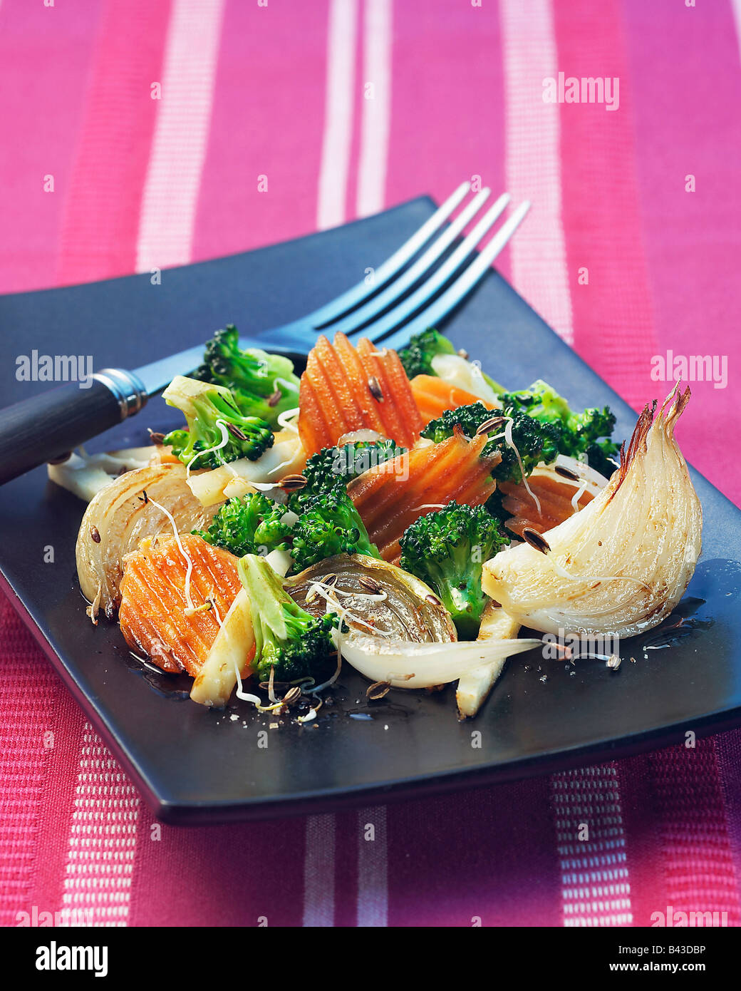 Pan-fried vegetables with sprouts - Stock Image