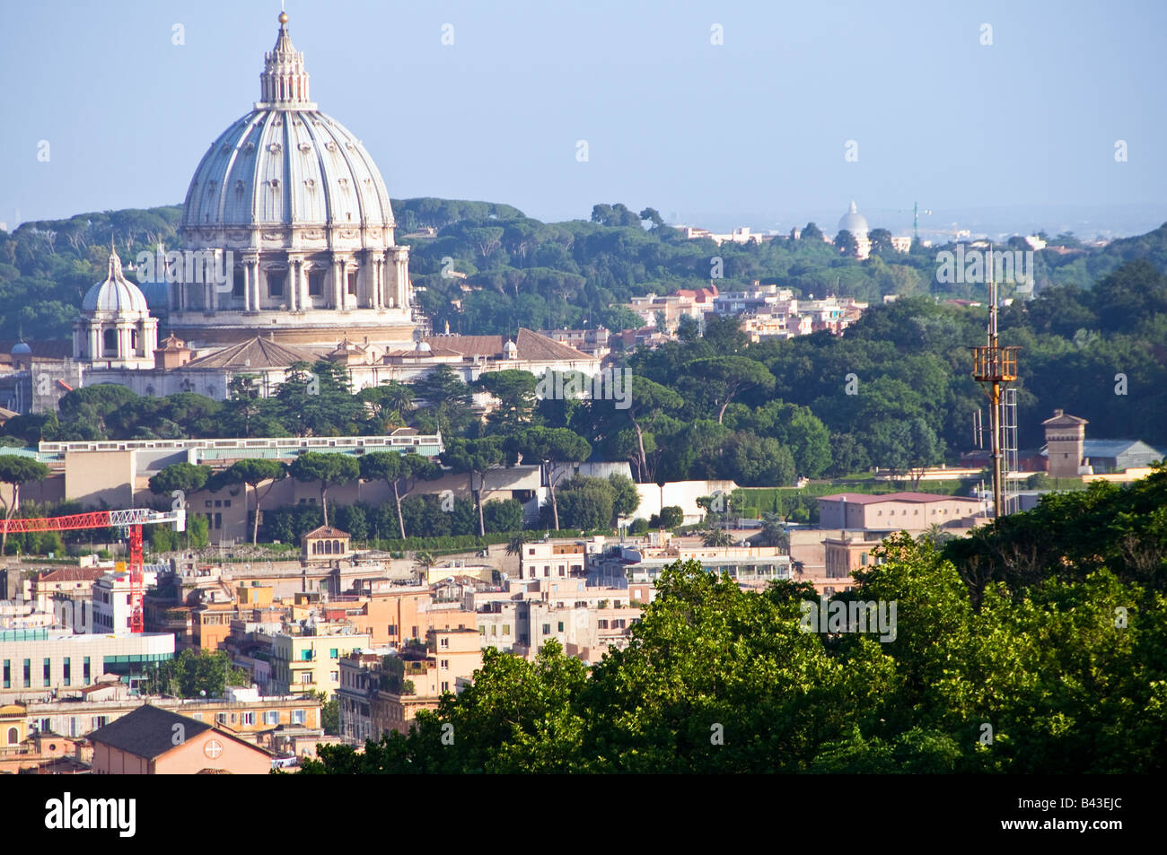 Scenic overview of Rome, Italy with Saint Peter's dome in the distance - Stock Image