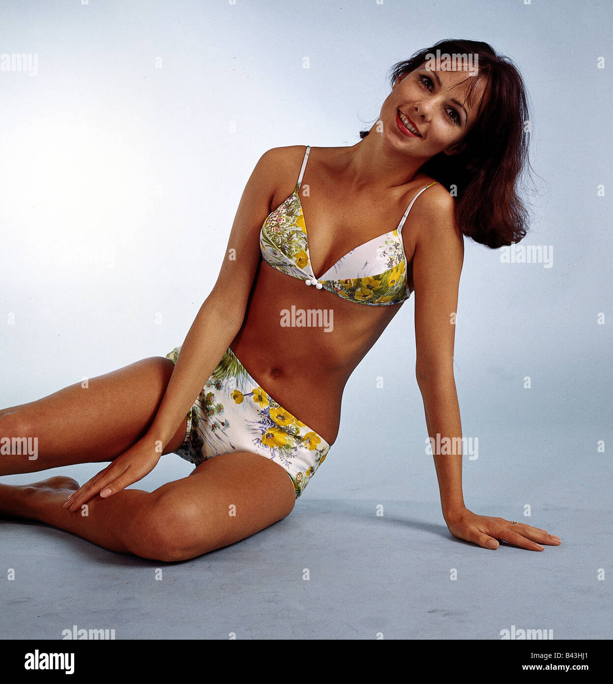 fashion, 1960s, model, wearing bikini, half length, sitting, studio, flower, flowers, , Additional-Rights-Clearances - Stock Image