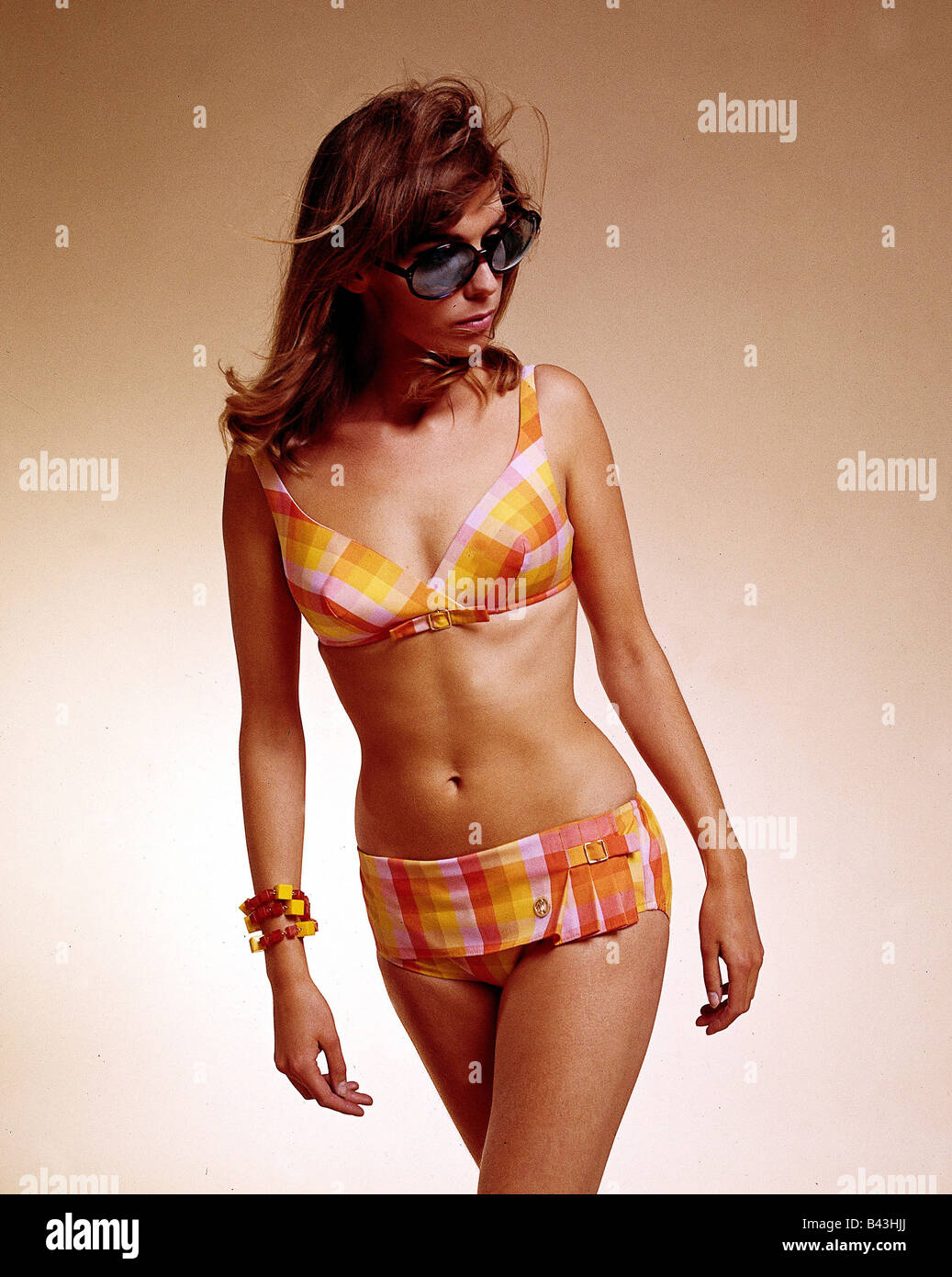 fashion, 1960s, model, wearing bikini, chequered, half length, studio, clothing, women, bathing suit, two-piece, - Stock Image