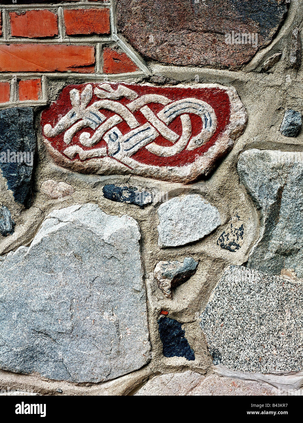 middle ages, Vikings, writing, runes, rune depicting the head of a dragon, fragment, rune stone, 8th / 9th century - Stock Image