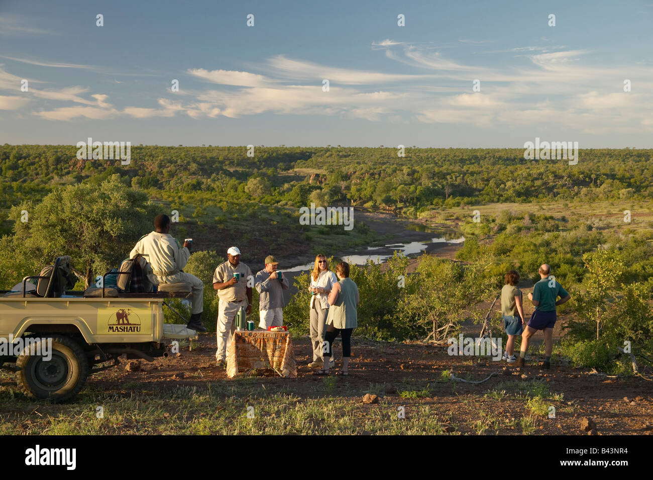 Guests on early morning game drive having a coffee break Mashatu Game Reserve Northern Thuli Block - Stock Image