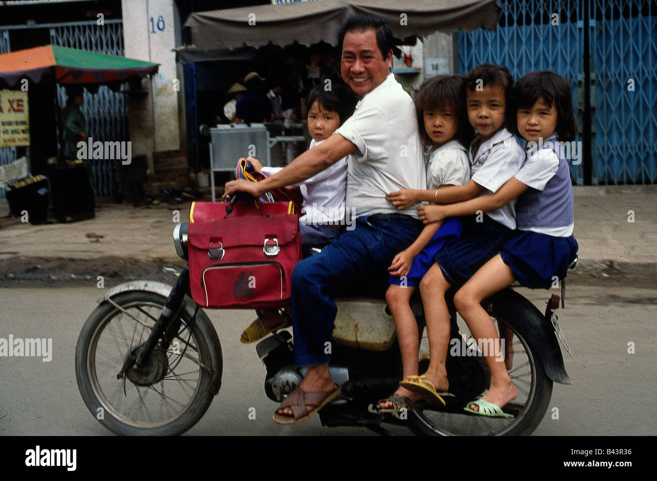 geography / travel, Vietnam, people, father with four children on a motor scooter, Saigon, children, overloaded, Stock Photo