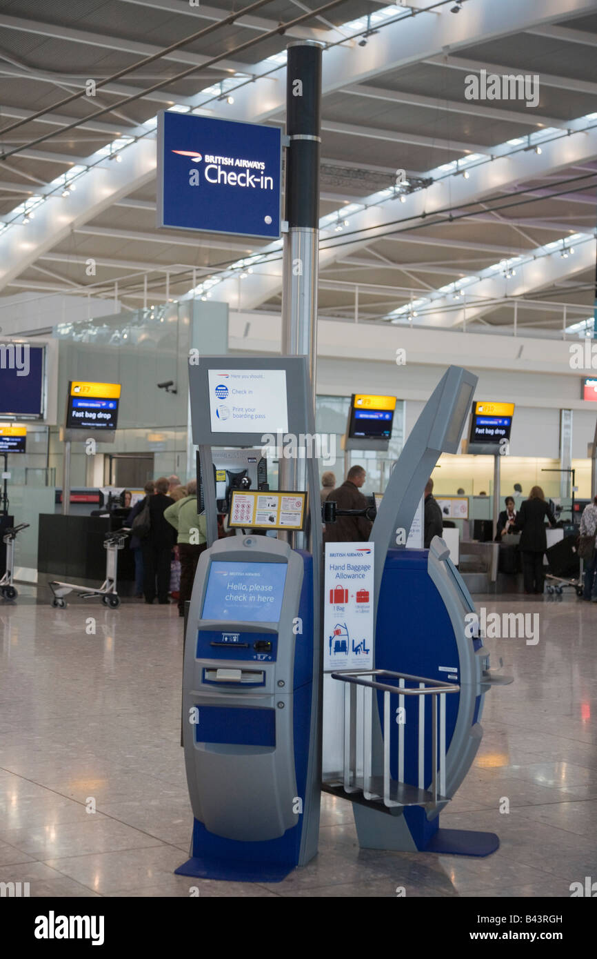 Heathrow London England UK Heathrow Airport international departures check-in kiosk for British Airways in Terminal - Stock Image