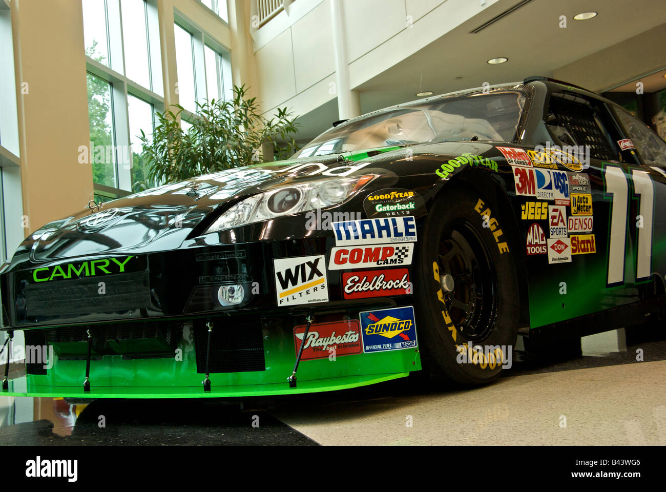 Denny hamlins toyota camry nascar car of tomorrow race car with sponsor decals on display at joe gibbs racing