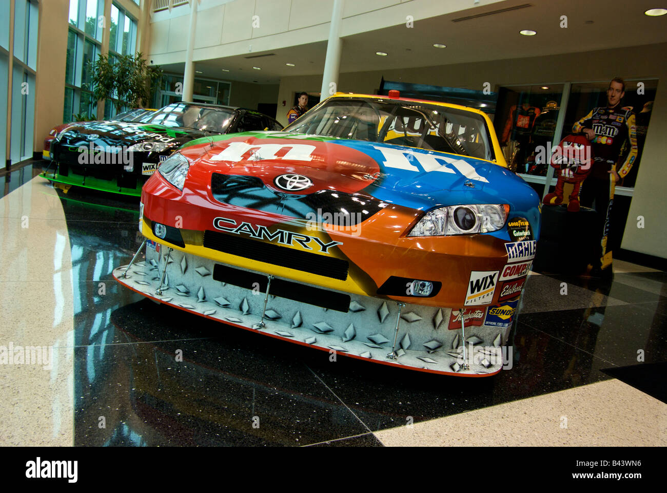 Kyle buschs mm toyota camry nascar race cars with sponsor decals on display at joe gibbs racing showroom