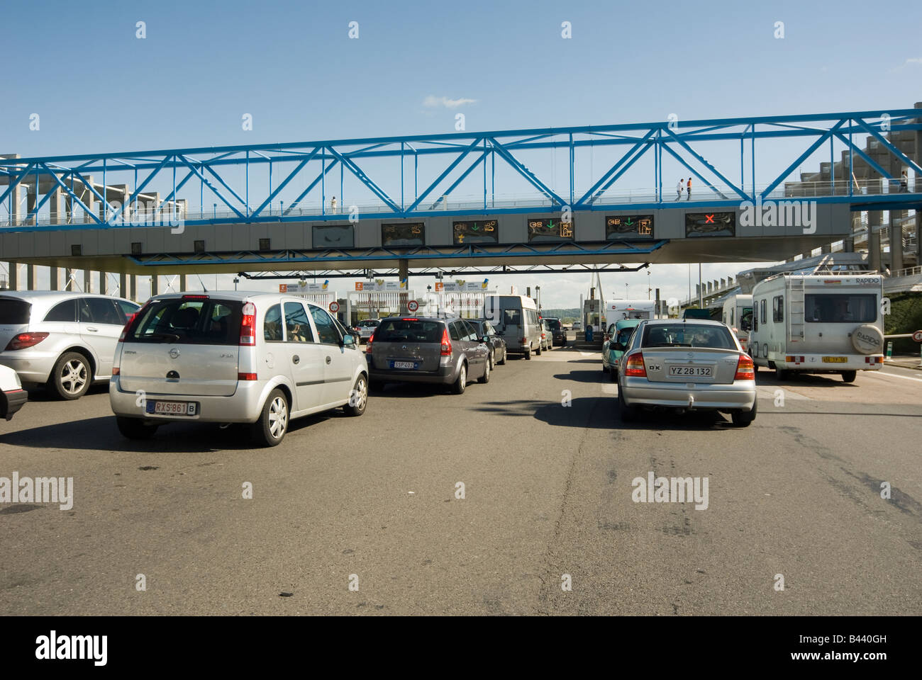 Cars queuing in heavy traffic at a toll booth on the A13 in Normandy Péage A13 Autoroute de Normandie France - Stock Image