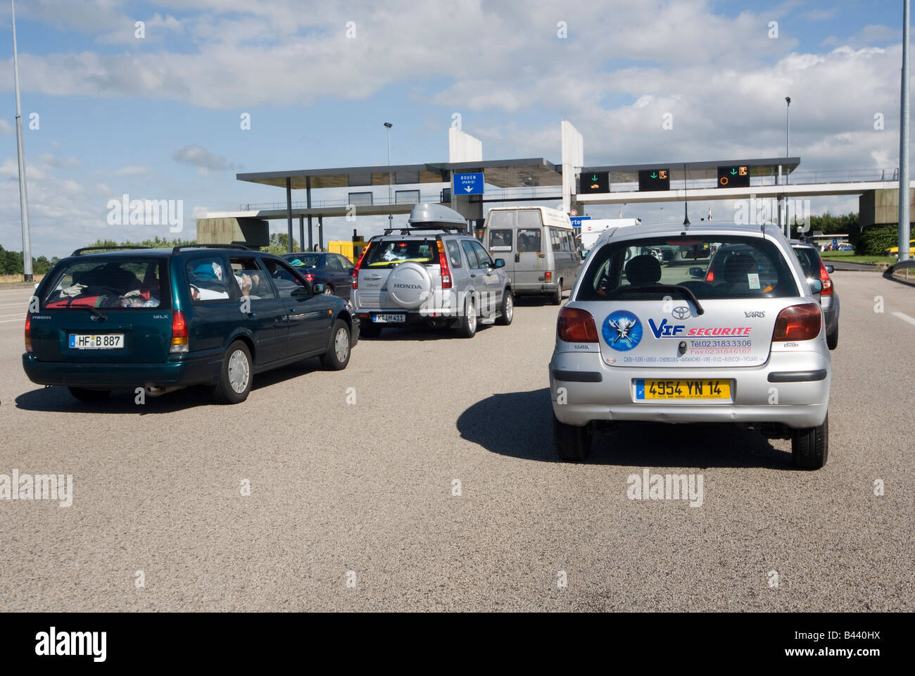 Cars queuing in traffic at a toll booth on the A13 in Normandy A13 Autoroute de Normandie France - Stock Image