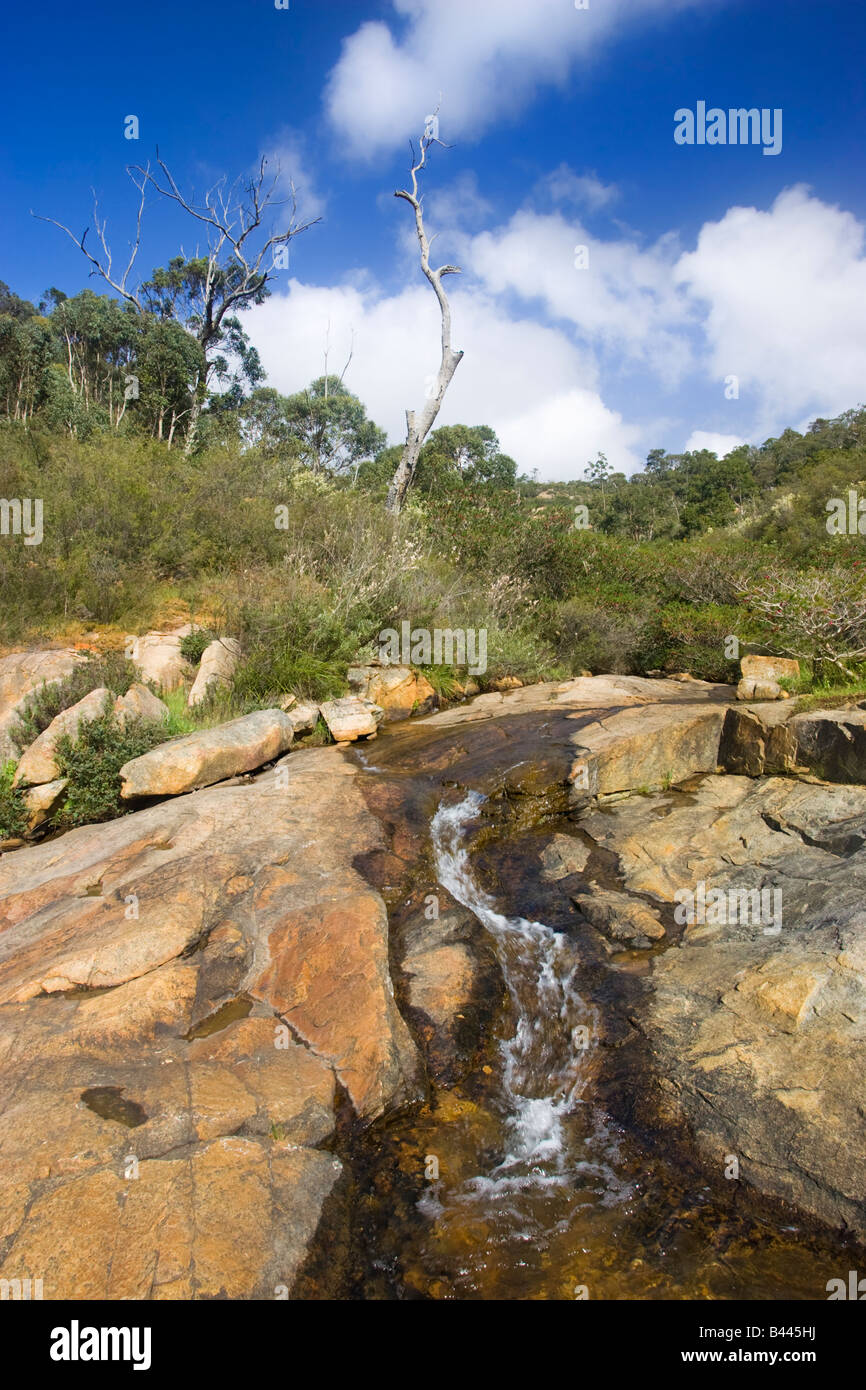 Ellis Brook flowing over granite on the Darling Scarp in Perth's Hills. Western Australia - Stock Image