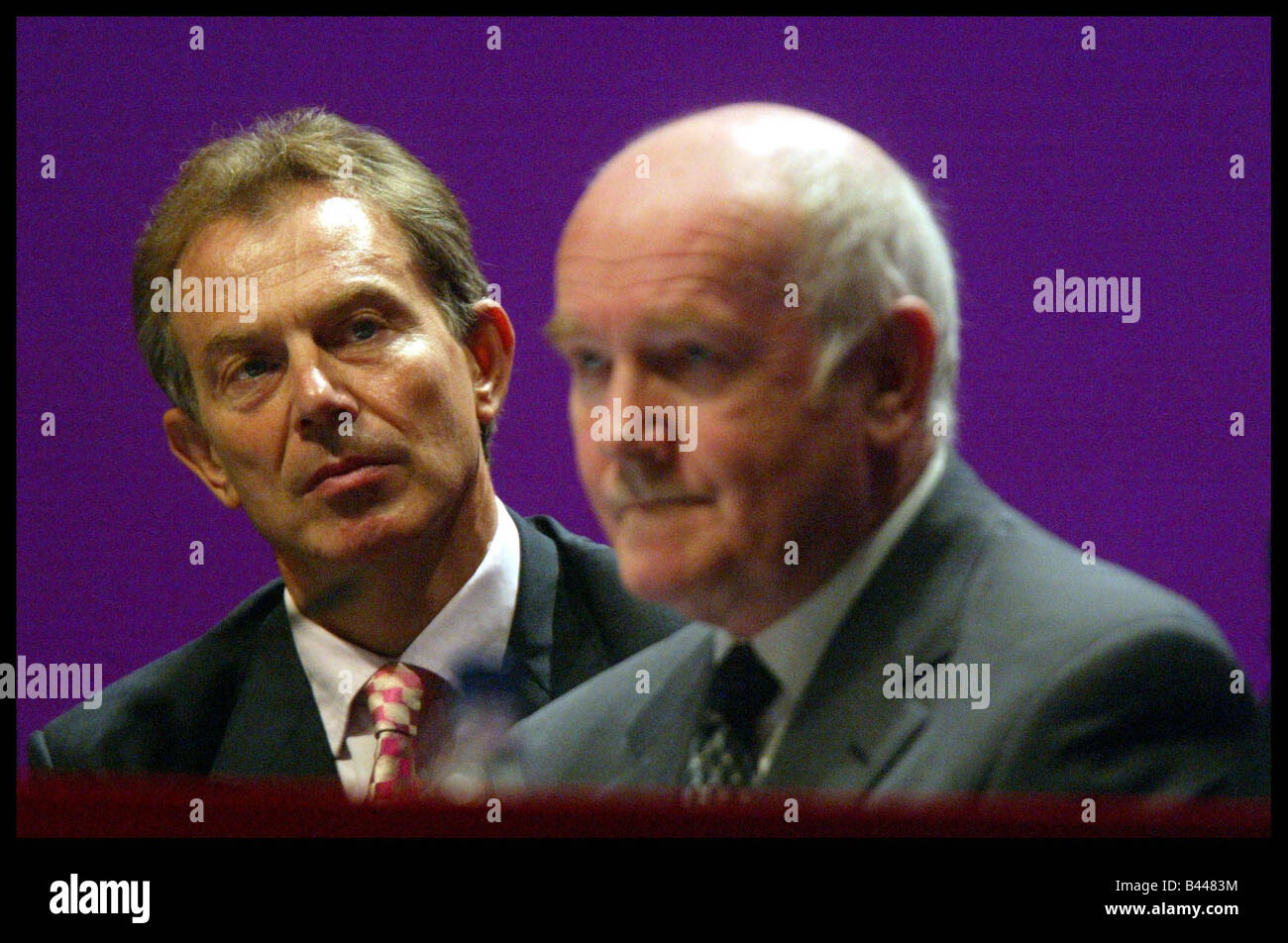 Labours Health Secretary John Reid speaking Tony Blair in backround at the Labour Party Conference Bournemouth October - Stock Image