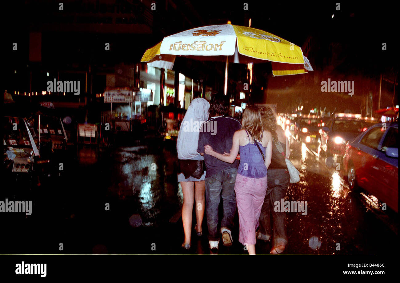 Escorted from Pat Pong to Soi Boy Bangkok in the pouring rain - Stock Image