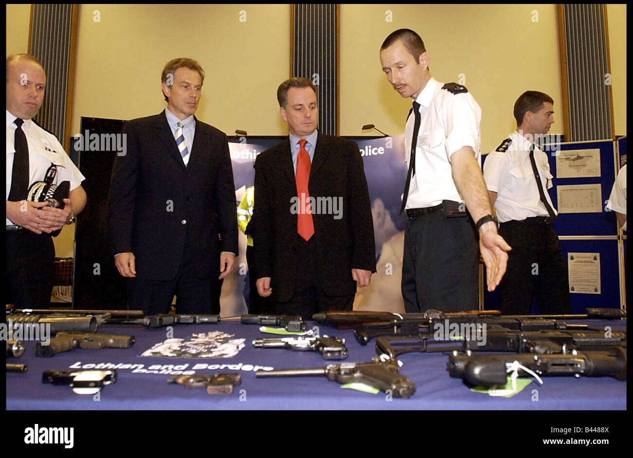 Tony Blair January 2003 on a visit to St leonard police station accompanied by First Minister Jack McConnell looking - Stock Image